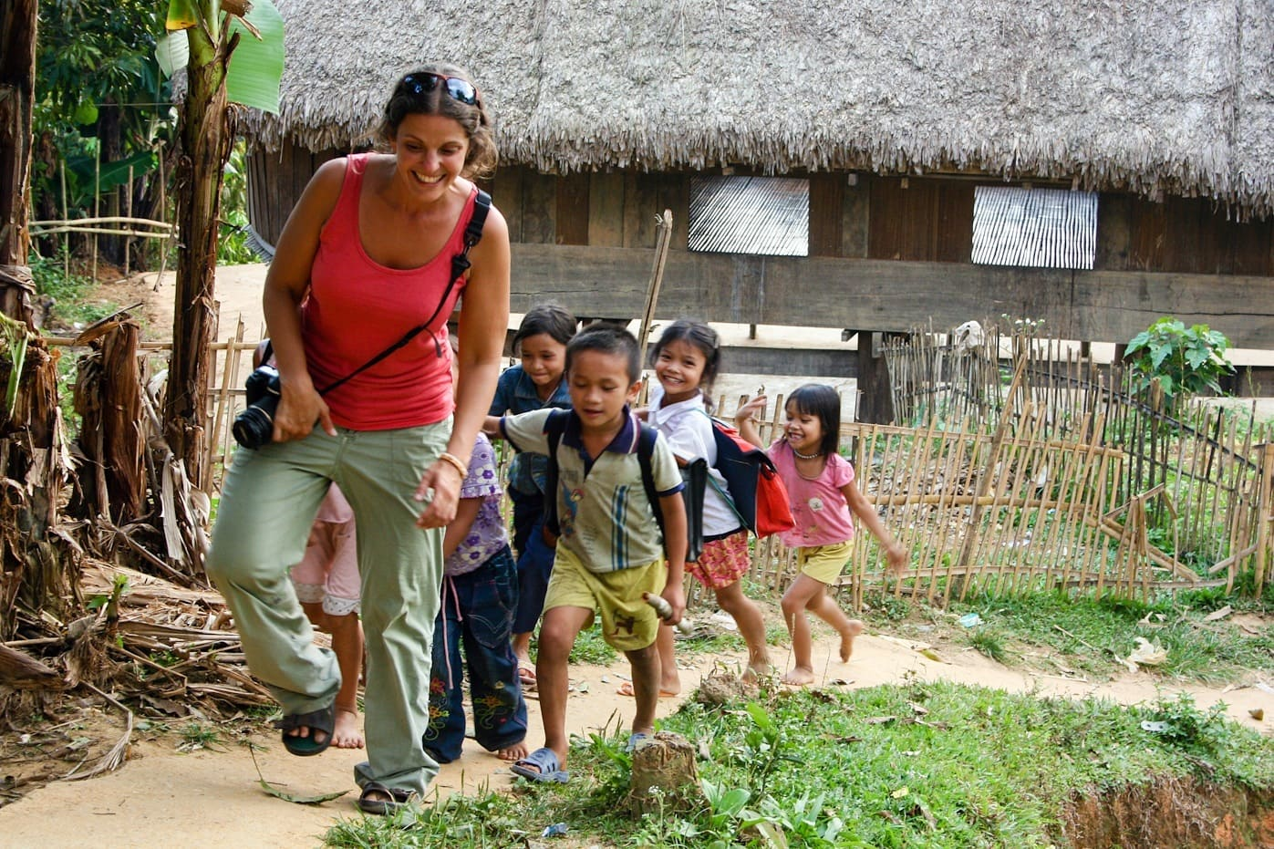 walking through the hills of vietnam with children following
