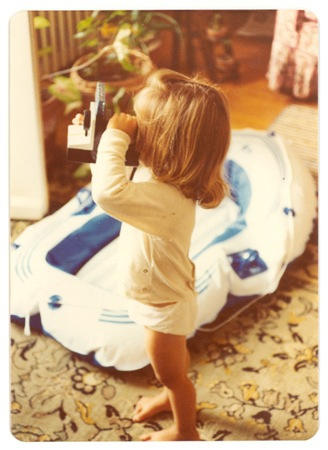 picture of jess kamens as a little girl taking an image with a polaroid learning how to become a photographer