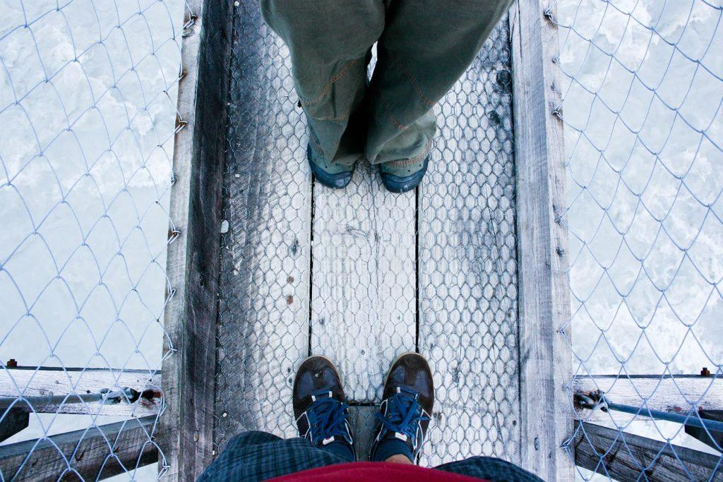 standing looking down on a bridge
