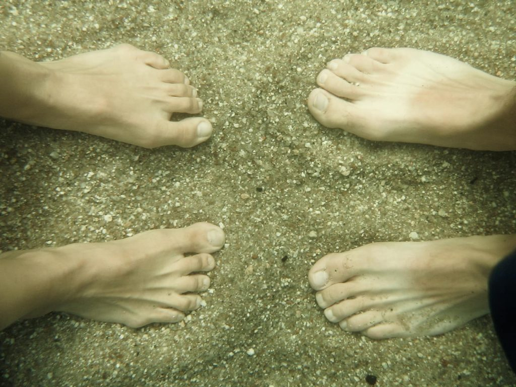 feet swimming under water