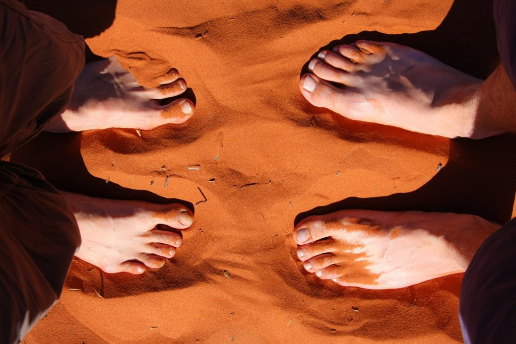 sand in the red desert with bright feet