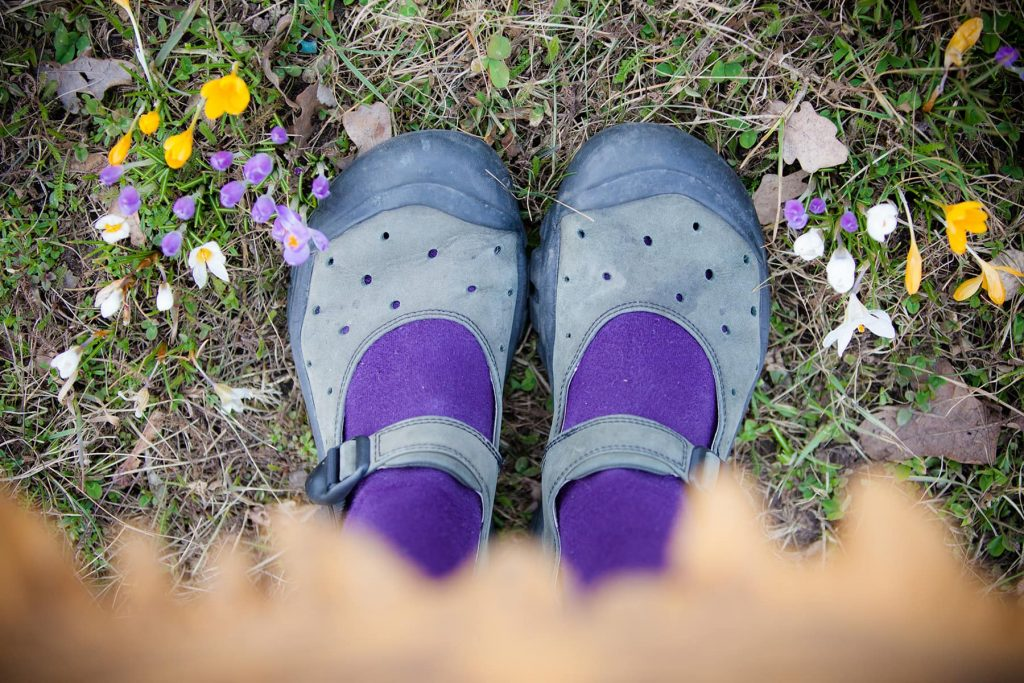 spring flowers with purple tights, green shoes and a yellow dress
