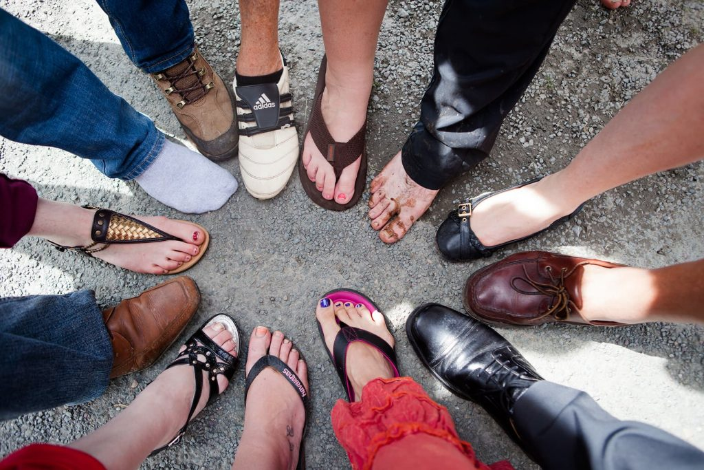 surrounded by family and friends in a circle of feet at the Joe Mooney Summer School
