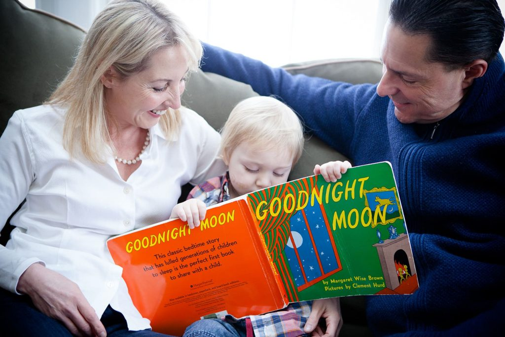 parents read their child Goodnight Moon