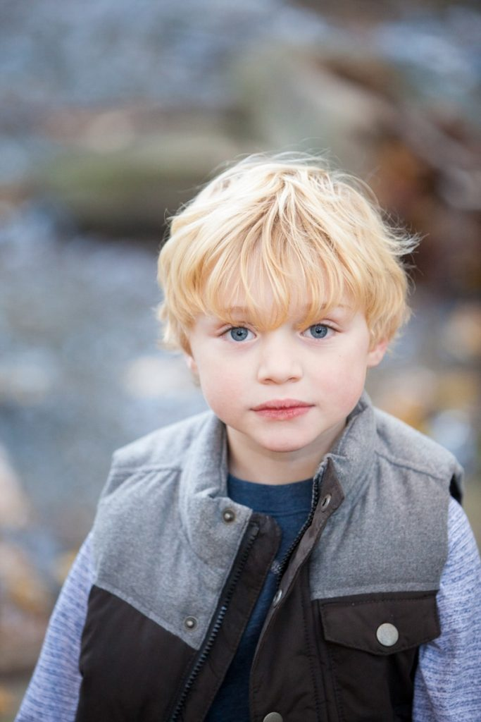 a boy dressed in a vest during his fall family session