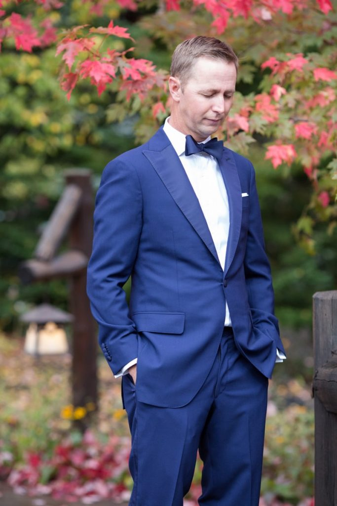 man waits for his new bride during the first look