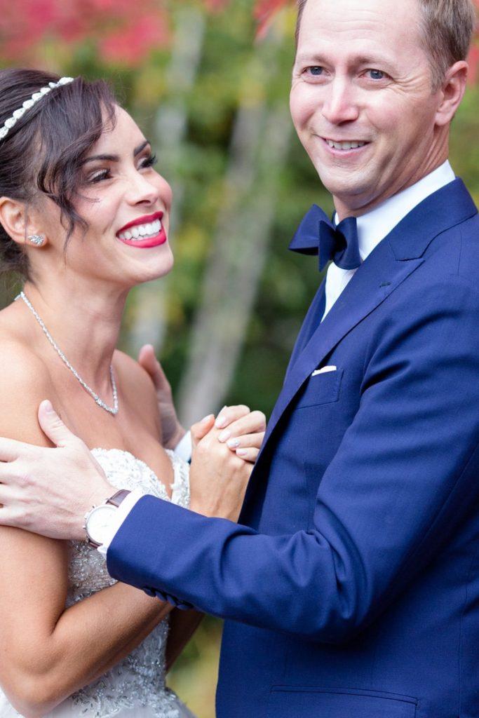 groom embraces his new bride