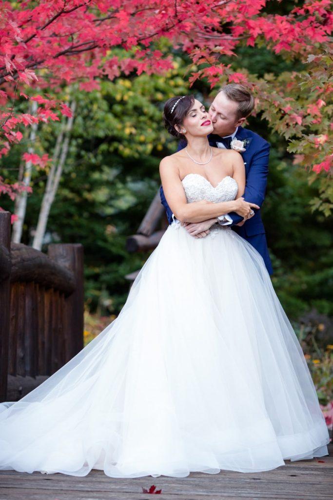 groom kisses bride's cheek