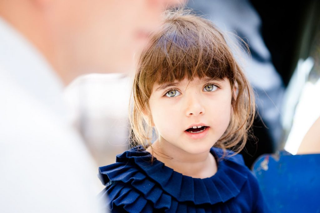 young girl with blue eyes looks at her father