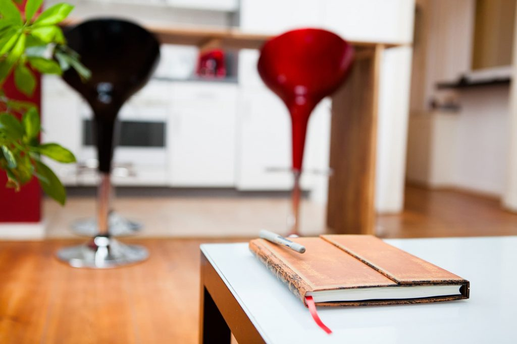 bar stools in a kitchen with a journal on the table