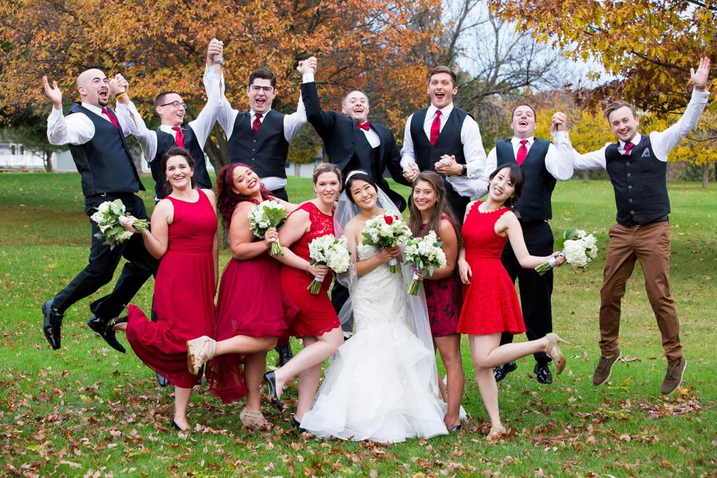 bridal party jumping on the golf course at Woodcliff