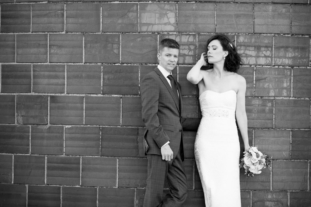 black and white city wedding photography against a water silo in rochester ny