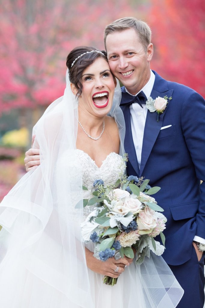 bride is cold during her winter wedding and smiling