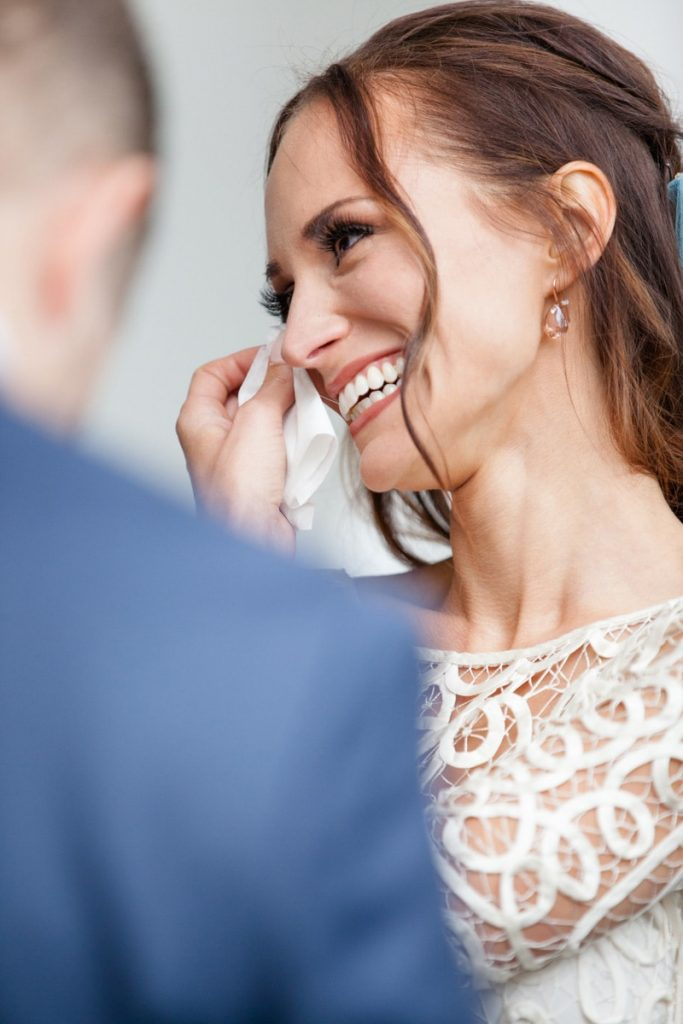 bride wipes her tears away curing her wedding ceremony at Rochester Brainery
