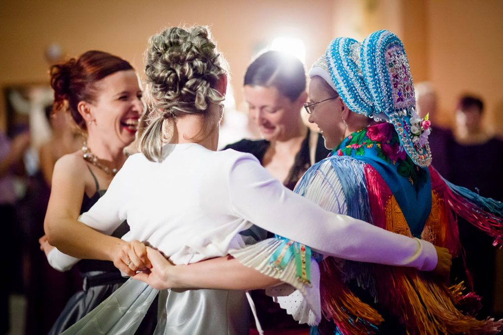 bride celebrates with her bridesmades during the traditional Slovak reception