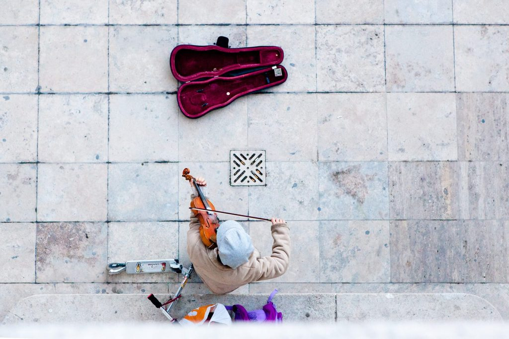 a photograph of a street busker taken from overhead