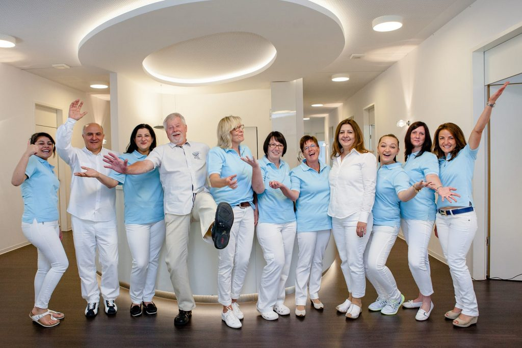 use business branding photography to show full staff with doctors dentists nurses and dental hygienist