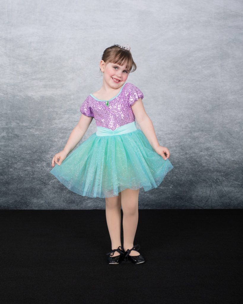 tap dance picture of a little girl in a purple dress with tap shoes