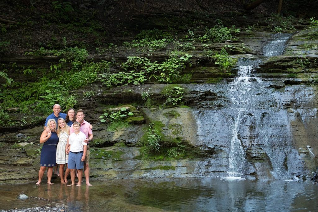 a family sessions leads to this beautiful family portrait near a waterfall in Canandaigua and Naples