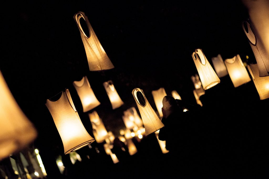 candle lanterns line an anniversary celebration outside