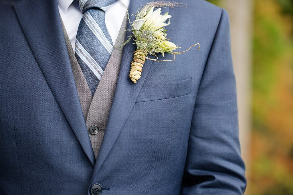 groom's suit and flower from Arena's in Rochester
