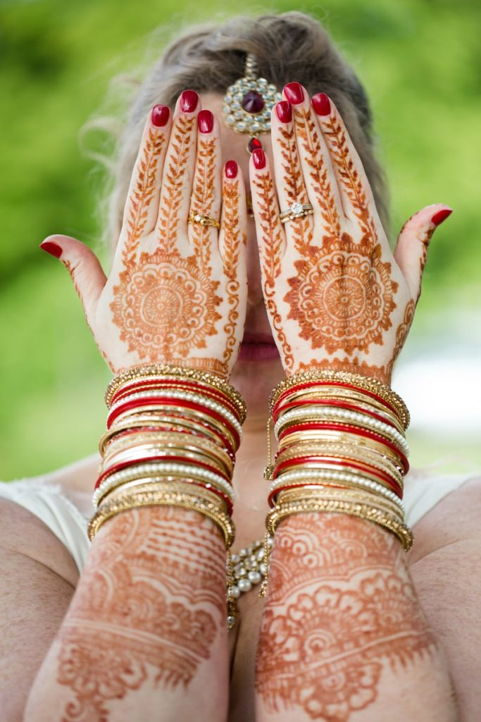 a bride has henna painted on her arms for her wedding