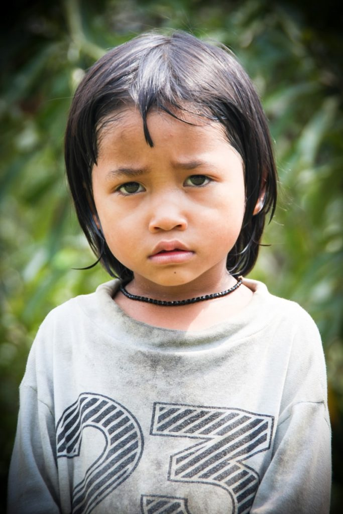 a Vietnamese child looks directly into the camera
