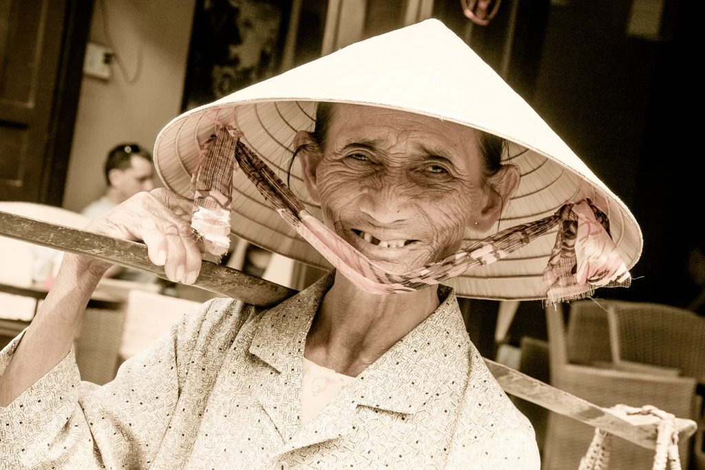 an old woman with a had smiles