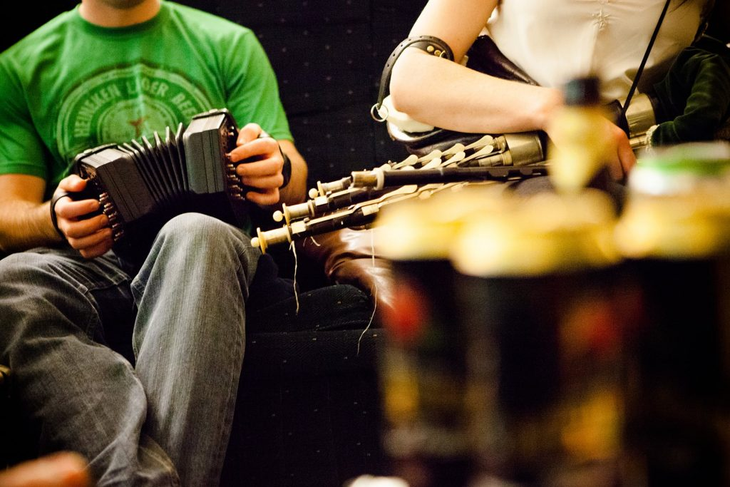 a concertina and a uilleann pipes player