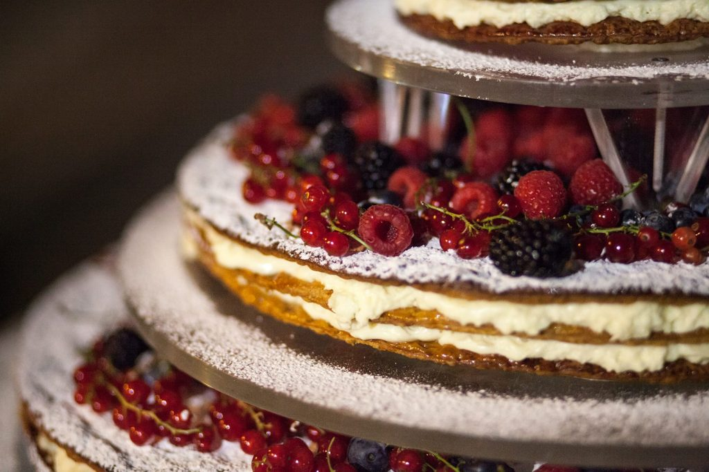 a beautiful, delicious, gourmet, tiered chocolate italian wedding cake with raspberries