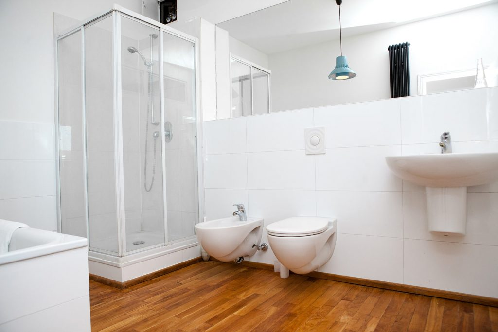 rental apartment with a newly decorated bathroom with double sinks and a shower