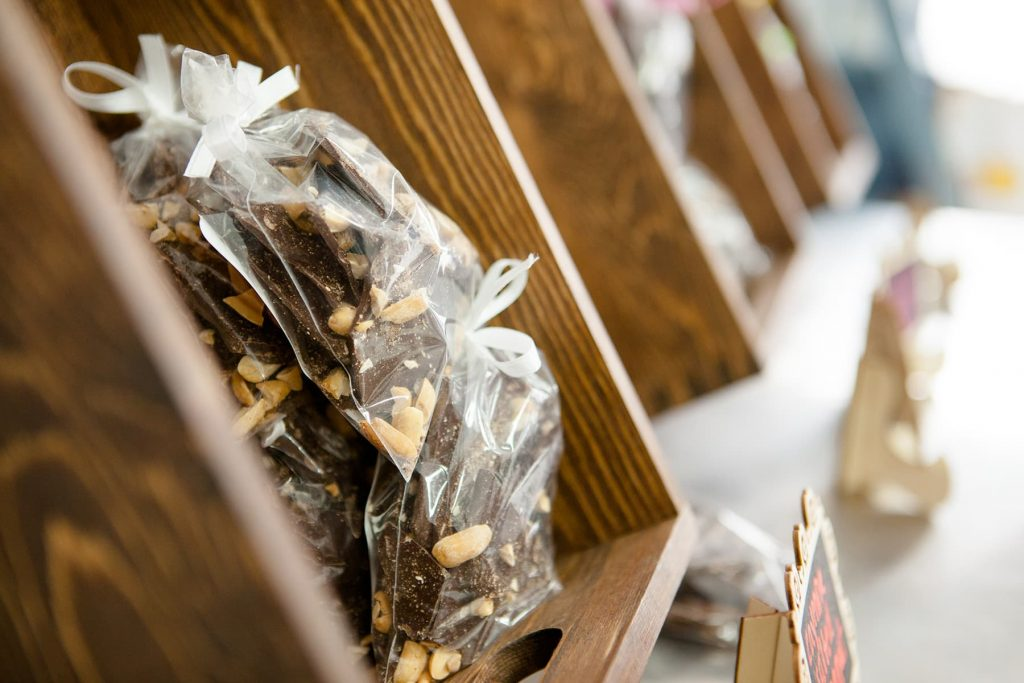 chocolate bark in packaging sitting inside a wooden box