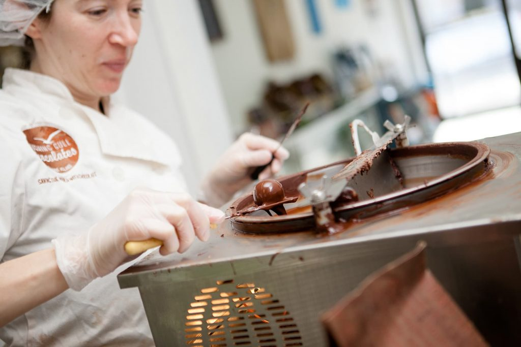 A woman working in her chocolate store in Rochester, NY