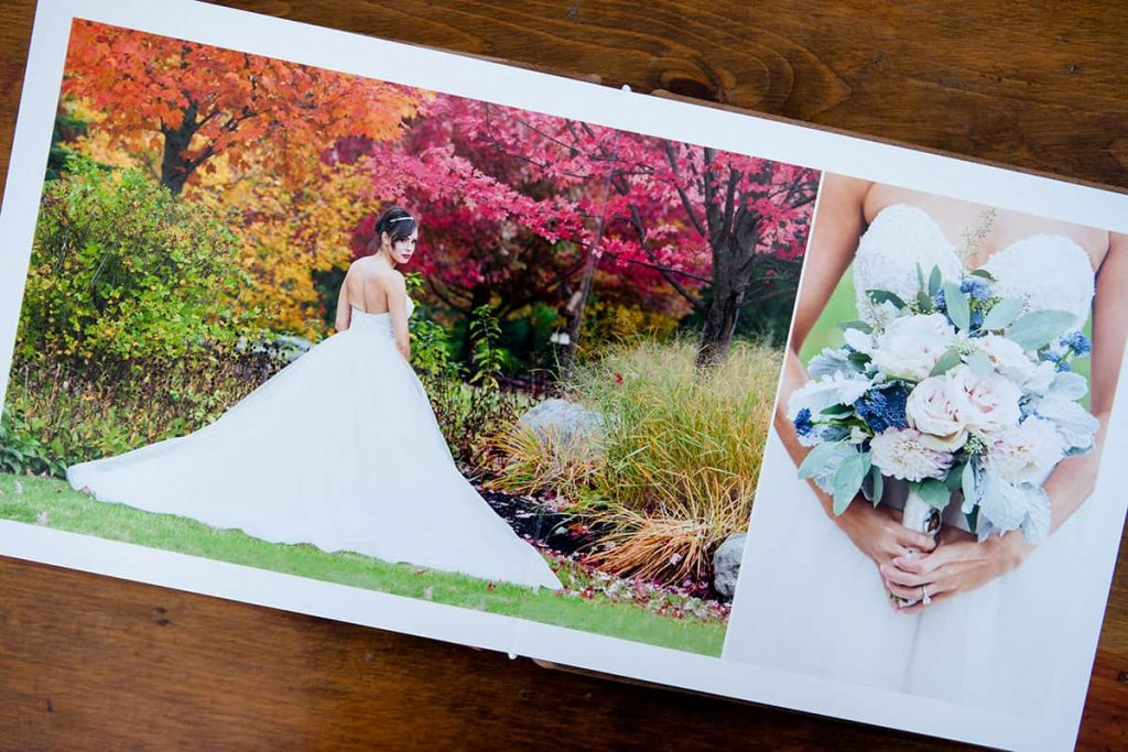 a lay-flat heirloom album with detail of a bride's dress