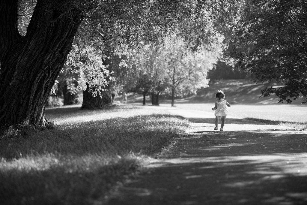 young toddler explores Genesee Valley Park in Rochester NY
