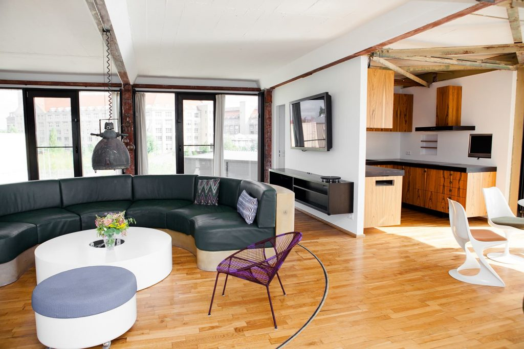 a luxury loft with large windows and a round couch