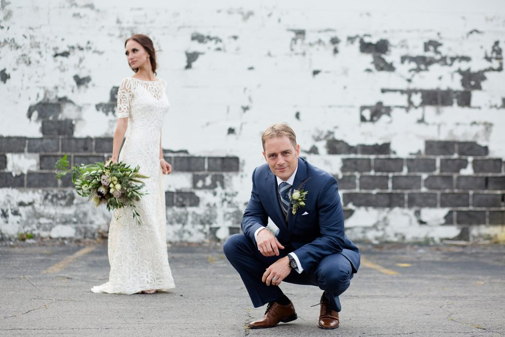 wedding photography in an urban city with a brick wall background in Rochester, New York