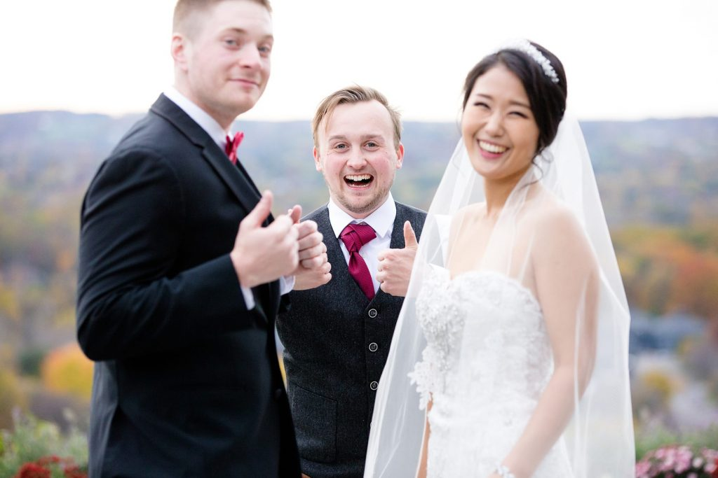 bride and groom with friend photobombing the wedding portrait