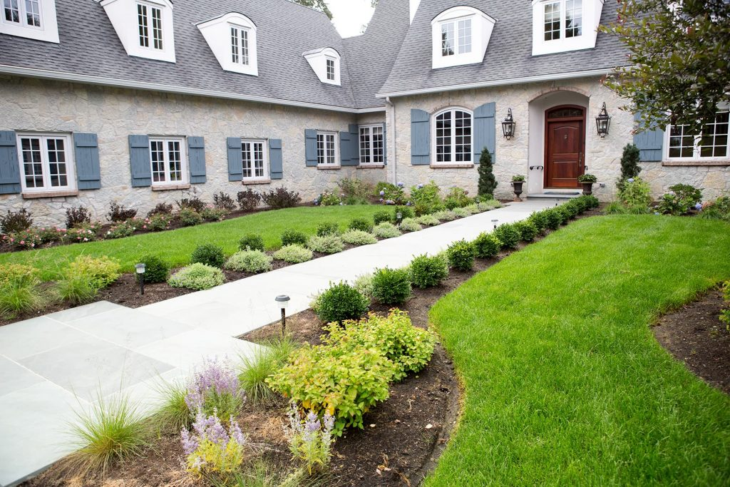 real estate photography of a stone home in Rochester, Ny with landscaping by RPK design