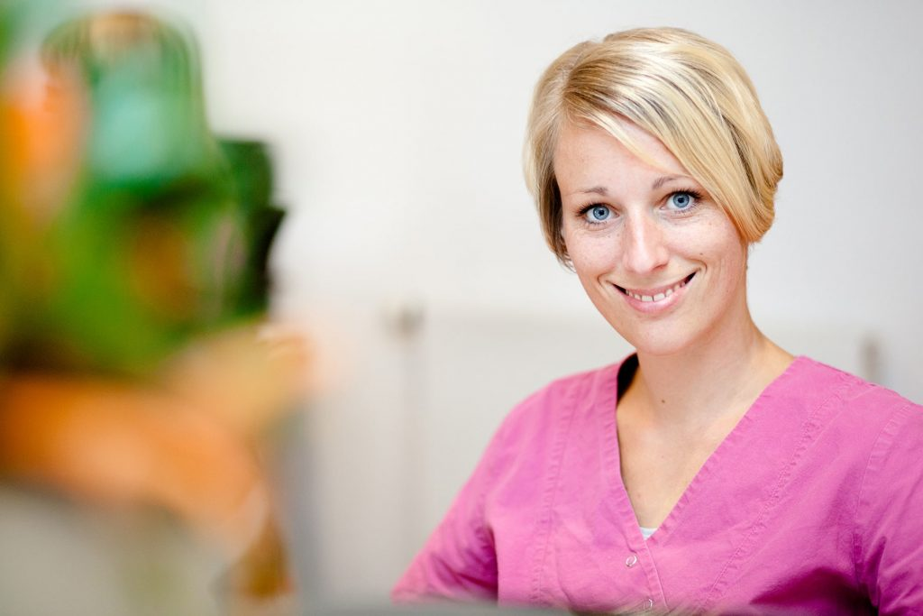 doctor's office receptionist smiling business headshot