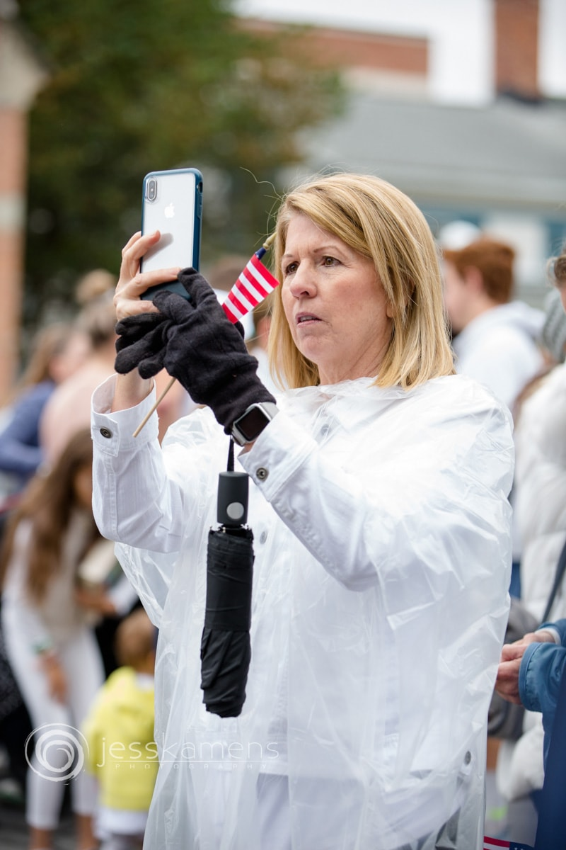 a woman documents the crowd