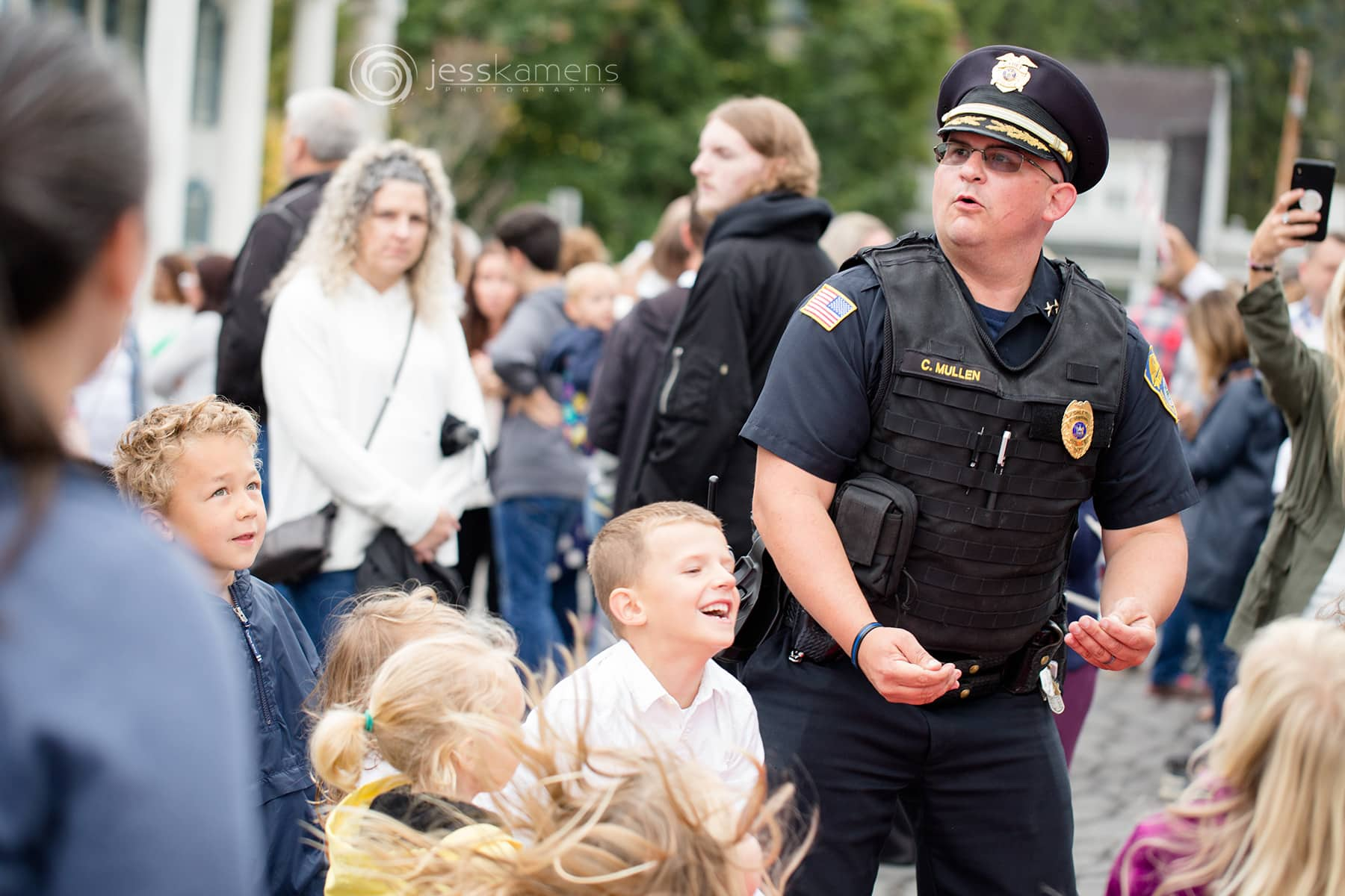 a policeman in Bath, NY plays ball with children