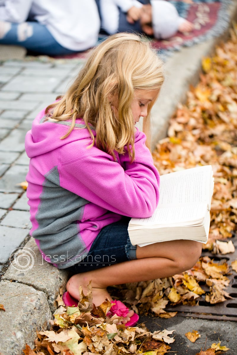 a homeschool child reads a large book