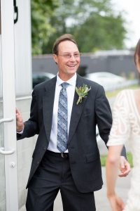 father welcomes bride on her wedding day