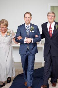 groom walks down the aisle