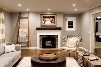 portrait installed over the fireplace in a luxury home