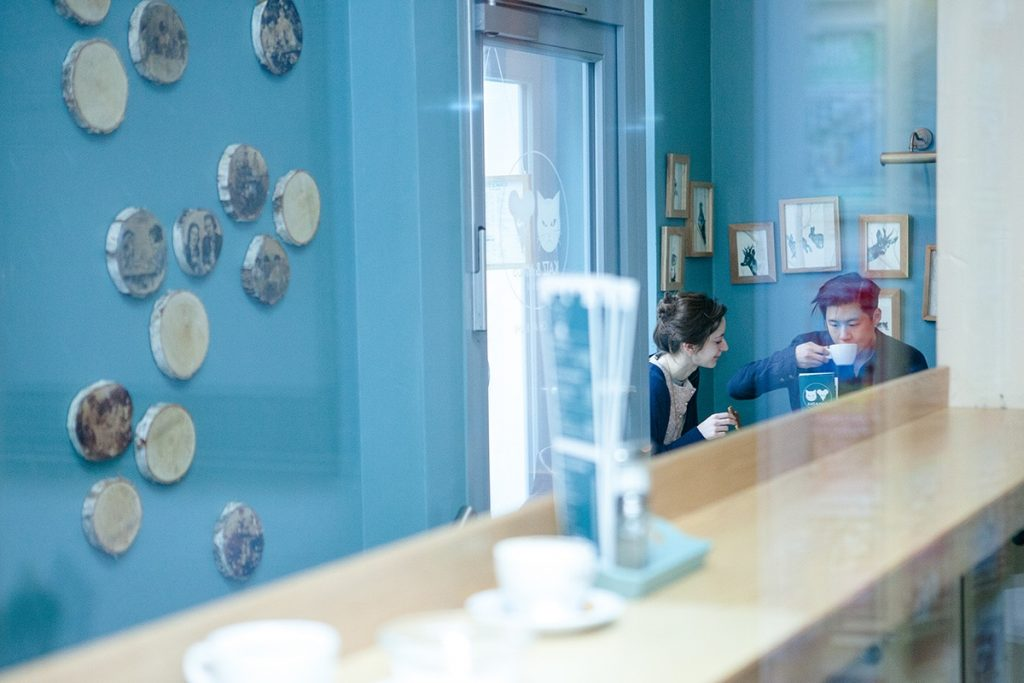 a branding image of people sipping coffee in a cafe