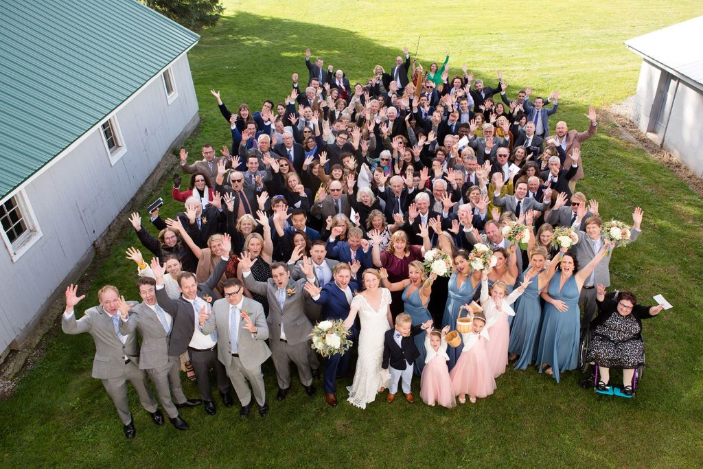 group picture of the all wedding guests from above