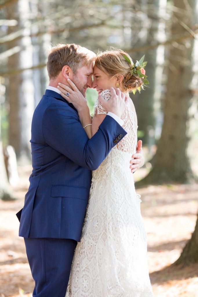 a sweet cuddle in the woods for new bride and groom