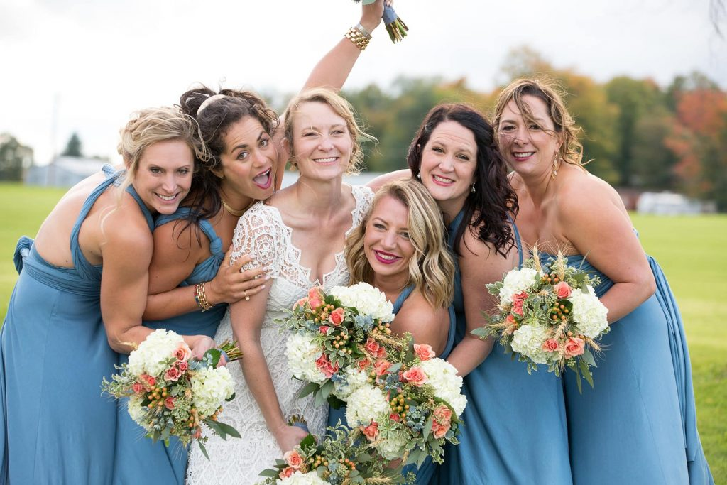 bridesmaids laugh and hug together